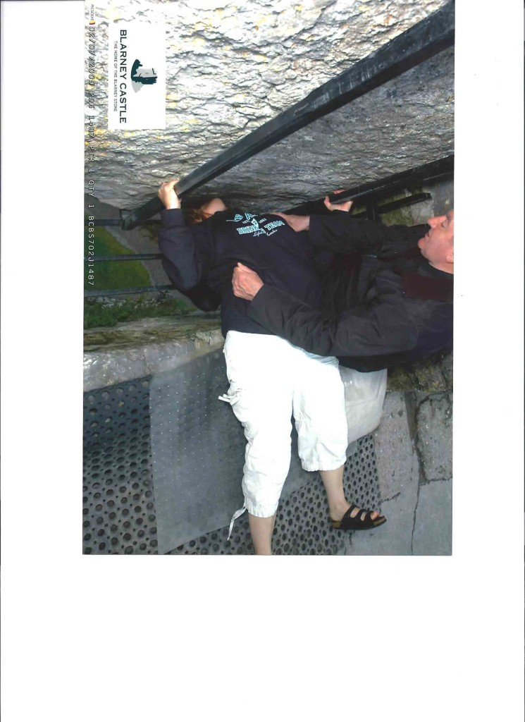 Hanging over the edge to kiss the blarney stone